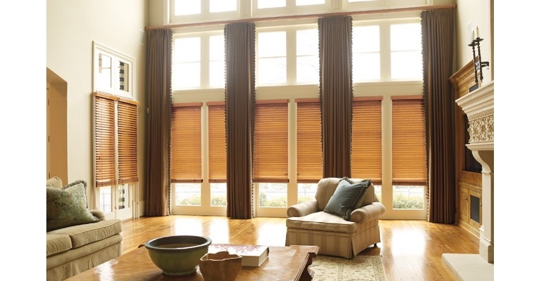 Southern California great room with natural wood blinds and floor to ceiling drapes.