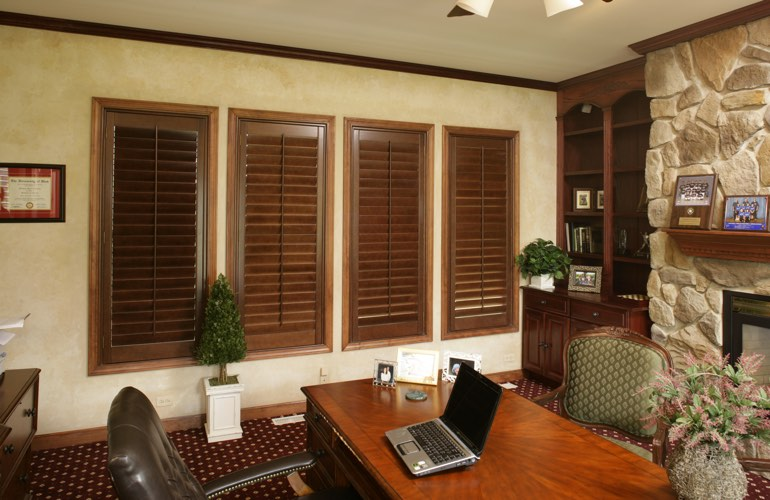 Hardwood plantation shutters in a Southern California home office