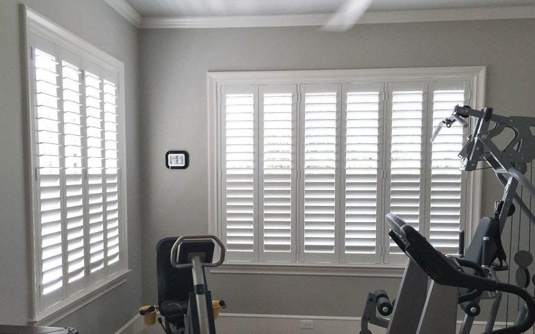 Southern California home gym with shuttered windows.
