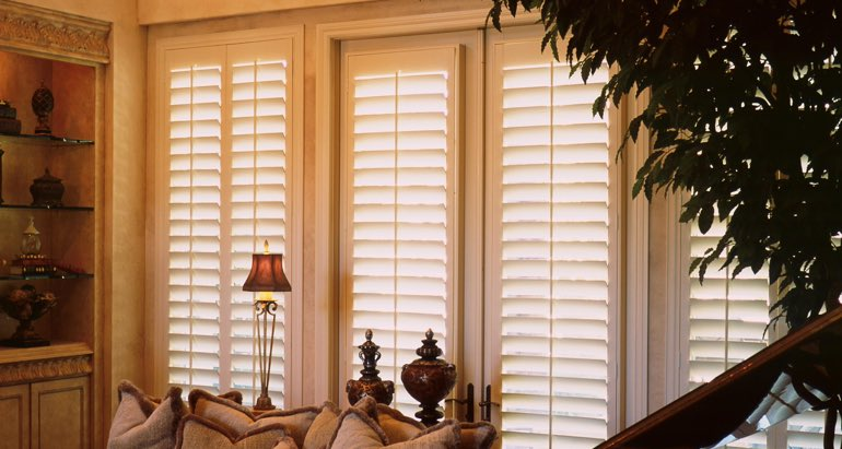 Plantation shutters on french door and window in Southern California parlor