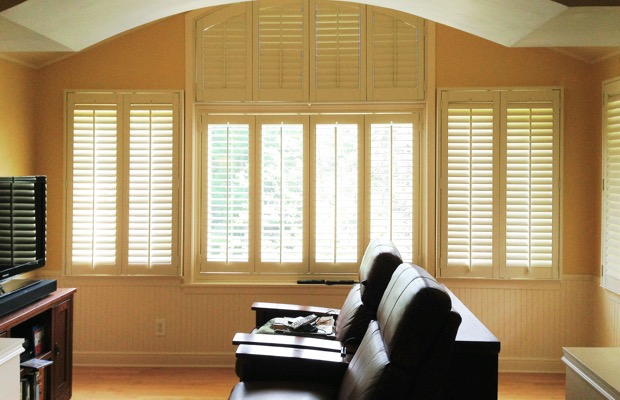 Southern California plantation shutters in tv room