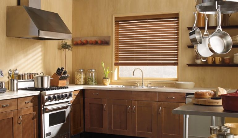 Southern California kitchen faux wood blinds.