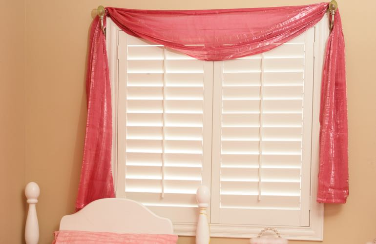 Girl's bedroom with plantation shutters.