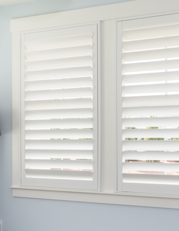 White plantation shutters with hidden tilt rods in Southern California