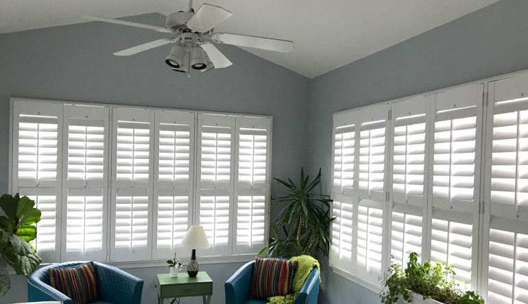 Southern California living room with fan and shutters