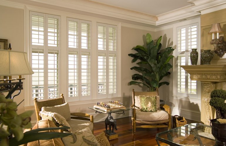 Living Room in Southern California with polywood plantation shutters.