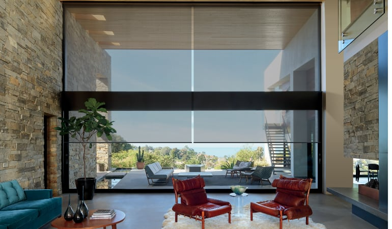 Motorized shades in a Southern California family room.