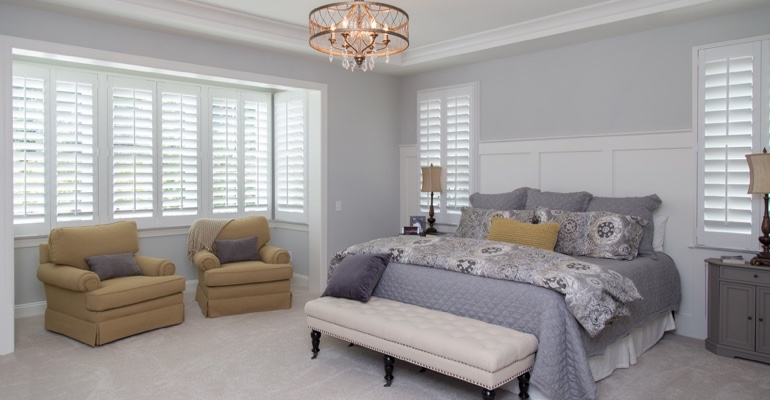 Interior shutters in Southern California bedroom.