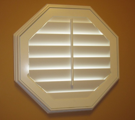 Southern California octagon window with white shutter