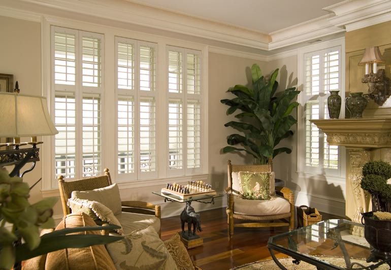 Study Interior With Hardwood Floors And Plantation Shutters.