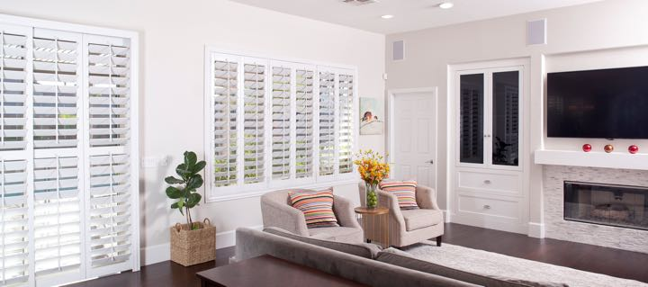 Southern California living room in white with plantation shutters.