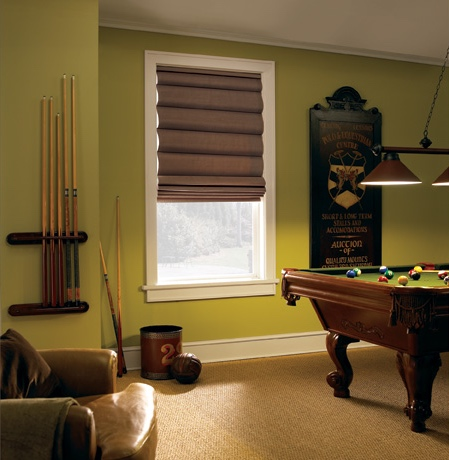 Roman shades in Southern California pool room with green walls.