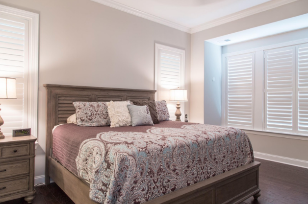 Southern California bedroom with light block shutters