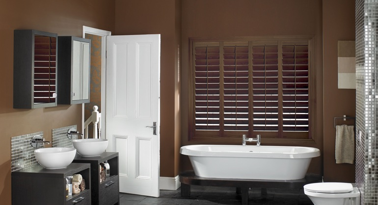 Stained wood shutter in Southern California bathroom