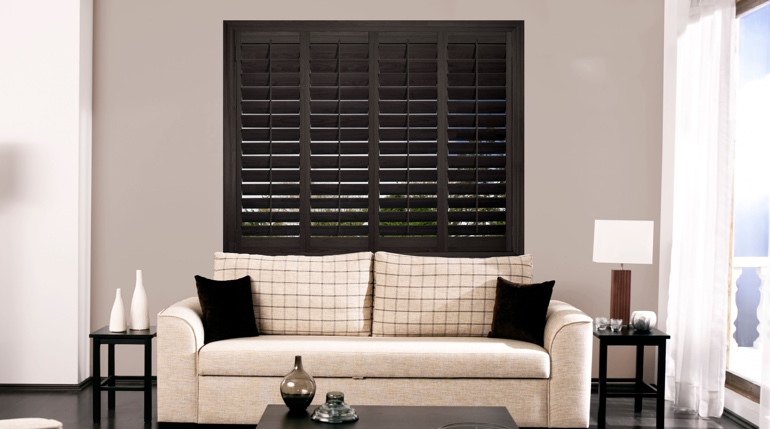 Southern California living room with plantation shutters.