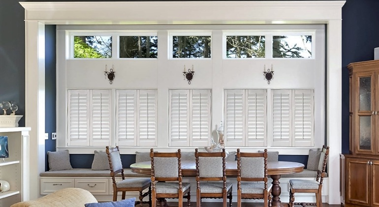 Shut classic plantation shutters in Southern California great room.