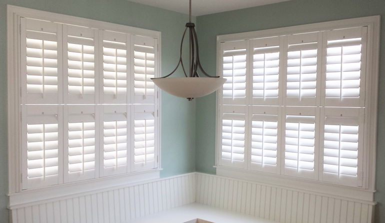 Pastel Green Wall In Southern California Kitchen With Shutters