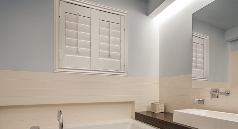 Studio waterproof shutters in Southern California bathroom.