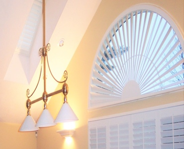 Southern California arched eyebrow window with white shutter