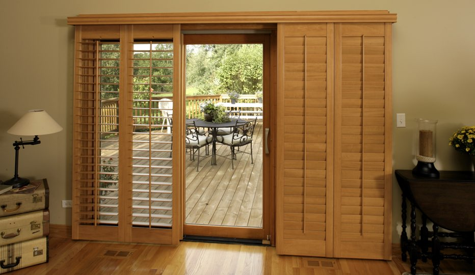 Bypass wood patio door shutters in Southern California living room