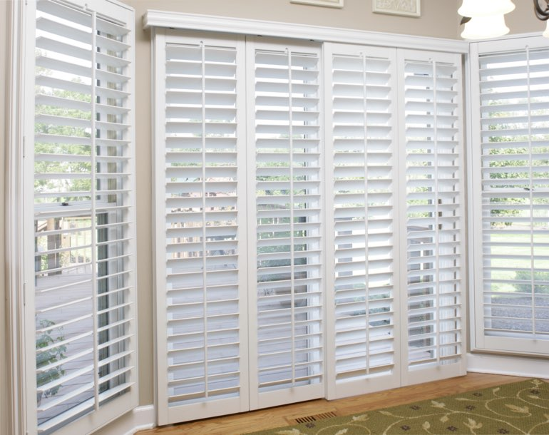 Sliding glass door with white shutters Southern California